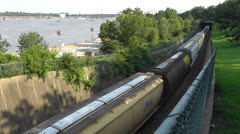 Train Travels Out One Tunnel Into Another Tunnel - stock footage
