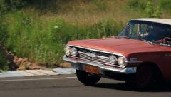Stock Video Footage of Fabulous American vintage car Chevrolet Impala driving over the road