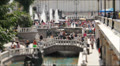 Fountains and people on Maneznaya Square, Moscow, Russia, tilt-shift. Footage