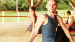 Yoga teacher conducts seminar for group of people Stock Footage