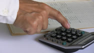 Stock Video Footage of Businessman using calculator
