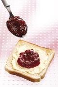 Breakfast, Slice of Toast with butter and raspberry jam, elevated view - stock photo