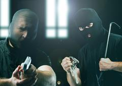 masked thieves - stock photo