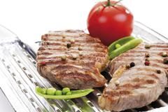 Grilled rumpsteak on aluminium grill pan Stock Photos