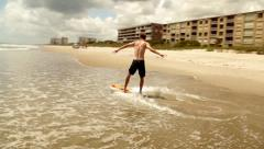 Stock Video Footage of Skim Boarding on the Ocean Beach