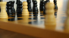 Wooden chessboard with pieces, camera movement, bright background Stock Footage