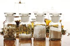 Apothecary flasks with Homoeopathic remedy, close-up - stock photo
