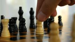 Taking risks, close-up of a man playing chess Stock Footage
