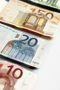 Various Euro bank notes in a row, elevated view - stock photo