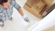 Stock Video Footage of man painting with white paint