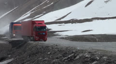 Cargo trucks drive from Russia through Georgia over mountain roads Caucasus Stock Footage
