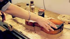 Music repair lab girl caressing violin Stock Footage
