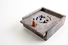 Incense cone burning, close-up Stock Photos