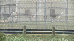Texas prisoners playing handball outside Stock Footage