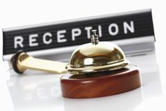 Reception sign with service bell and hotel key on white background Stock Photos