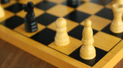 Wooden chessboard with pieces, chess Stock Footage