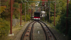 Cable Car Descending Autumn Mountain in Japan Stock Footage