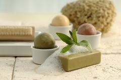 Stock Photo of Different soaps with nail brush and sponge