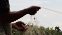 Fisherman Hands Untangling Net Stock Footage