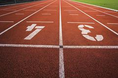 Painted '3' and '4' on running track - stock photo