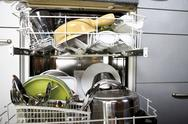 Stock Photo of Cleaned dishes in open dishwasher, close-up