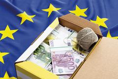 Stock Illustration of Money parcel on european union flag, close-up