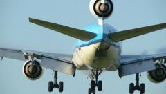 Three engine airplane landing backview 11009 Stock Footage