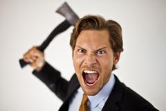 businessman wielding axe - stock photo