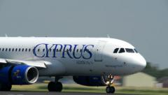 CYPRUS Airways airplane touch down roll close 11012 Stock Footage