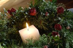 Burning candle in chaplet Stock Photos