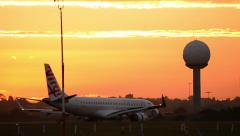 Virgin Jet taxing at Airport at Sunset 160GYAP 5983 NTSC Stock Footage