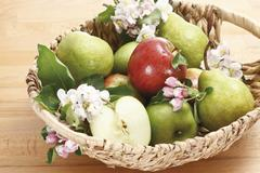 Apples, Pears and blossoms in basket, elevated view Stock Photos