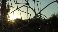 Fences in front of the sun (1) - stock footage