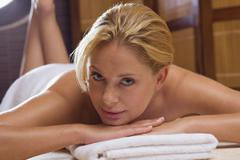 Stock Photo of germany, young woman lying on massage table