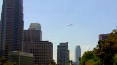 Distant Blimp Flying High Above Los Angeles Skyline Stock Footage
