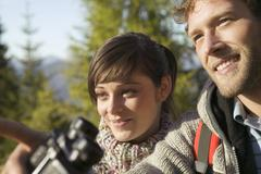 young couple, man holding binocular - stock photo