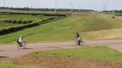 Family riding bikes Stock Footage