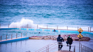Stock Video Footage of Swimmers in blue Ocean Pool braving waves  171GYCC NTSC