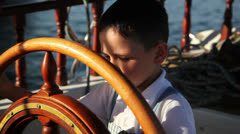 Little boy driving a boat 2 Stock Footage