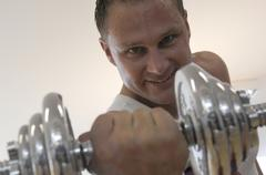 Stock Photo of Man Lifting a Dumbbell, portrait, close-up