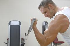 Man doing arm curls with dumbbells - stock photo