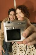 Couple taking photograph of themselves Stock Photos