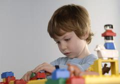 Boy playing with bricks - stock photo