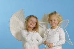 Girls (3-4) dressed as angels - stock photo