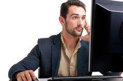 suprised man looking at a computer monitor - stock photo
