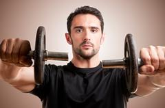 Man working out with dumbbels Stock Photos