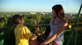 child with her mother on the Ferris wheel 4 HD Footage