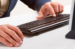 Man working at a computer keyboard Stock Photos