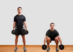 dumbbell squat - stock photo