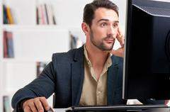 Suprised man looking at a computer monitor Stock Photos